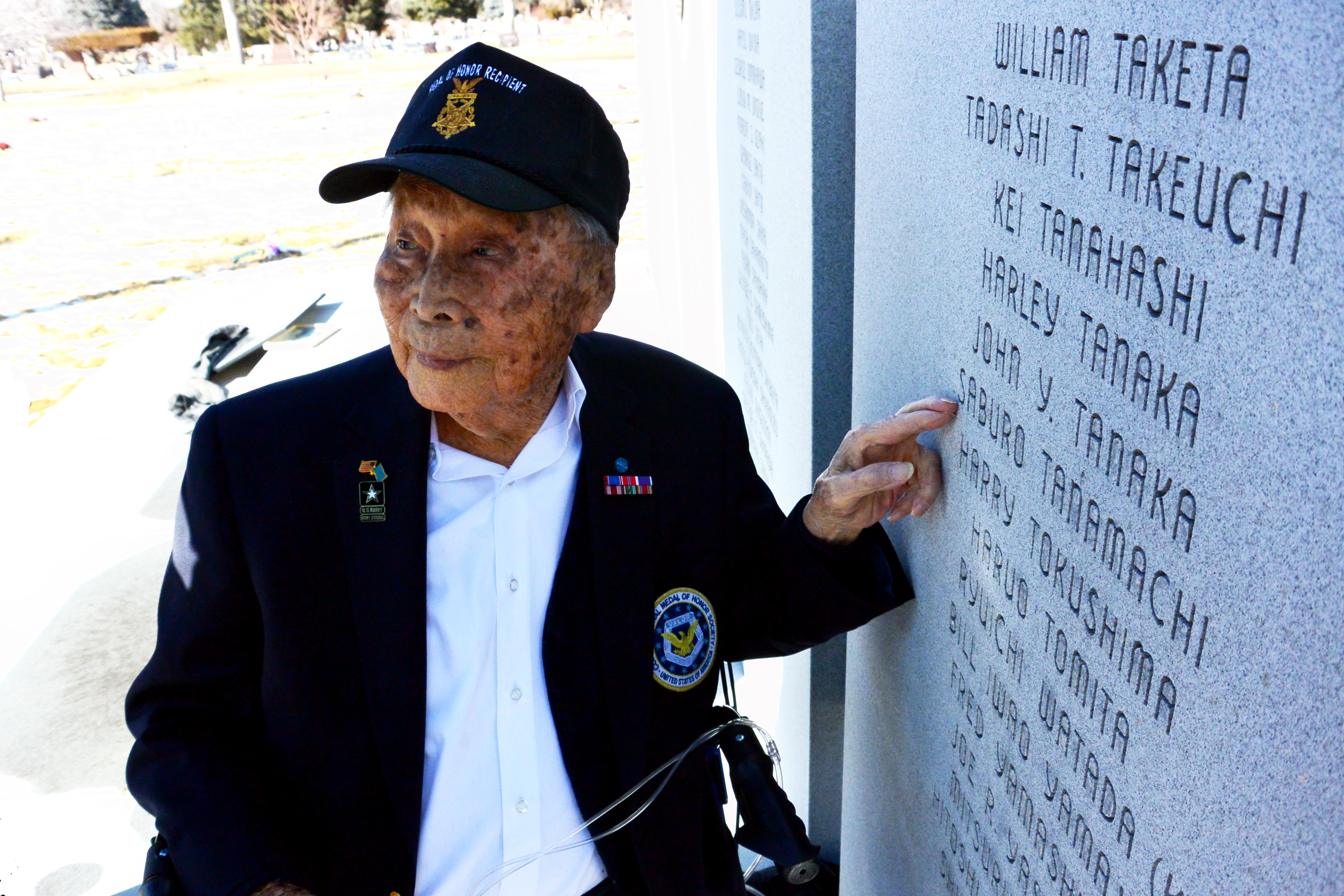"Joe Sakato points to the name of his friend Saburo Tanamachi, who died in his arms during the WWII battle to rescue the ""Tecas Lost Battalion."""